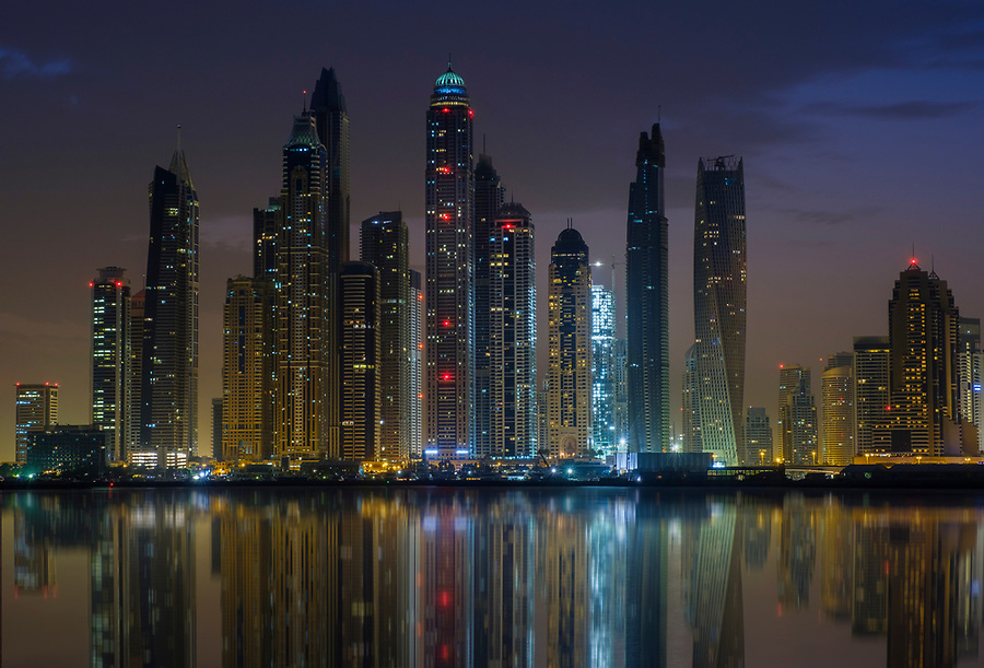 UNITED ARAB EMIRATES, DUBAI - CIRCA JANUARY 2017: Dubai Marina cityscape and skyscrapers as seen from Palm Jumeirah at dusk.