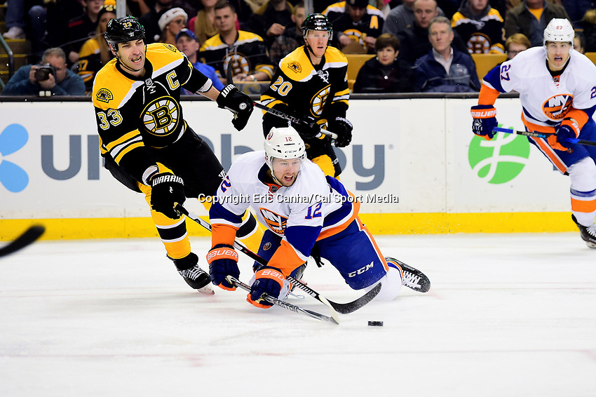 Tuesday, December 20, 2016: Boston Bruins defenseman Zdeno Chara (33) reaches in to poke the puck away from New York Islanders left wing Josh Bailey (12) during the National Hockey League game between the New York Islanders and the Boston Bruins held at TD Garden, in Boston, Mass. The Islanders defeat the Bruins 4-2. Eric Canha/CSM