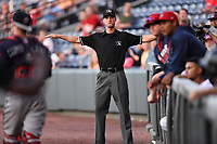 Umpire Darrell Roberts makes a call in a game between the Greenville Drive and the Rome Braves on Wednesday, May 31, 2017, at Fluor Field at the West End in Greenville, South Carolina. Greenville won, 7-1. (Tom Priddy/Four Seam Images)