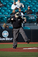 Home plate umpire Craig Mirr calls a batter out on strikes during the NCAA baseball game between the Illinois Fighting Illini and the Coastal Carolina Chanticleers at Springs Brooks Stadium on February 22, 2020 in Conway, South Carolina. The Fighting Illini defeated the Chanticleers 5-2. (Brian Westerholt/Four Seam Images)