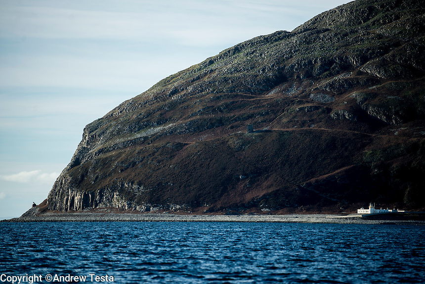 Scotland. Ailsa Craig . 10th November 2013<br /> Ailsa Craig, it's lighthouse on right and at far left a fog horn<br /> &copy;Andrew Testa for the New York Times