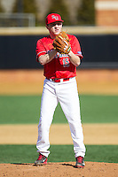 Radford Highlanders relief pitcher Kyle Zurak (15) looks to his catcher for the sign against the Missouri Tigers at Wake Forest Baseball Park on February 21, 2014 in Winston-Salem, North Carolina.  The Tigers defeated the Highlanders 15-3.  (Brian Westerholt/Four Seam Images)