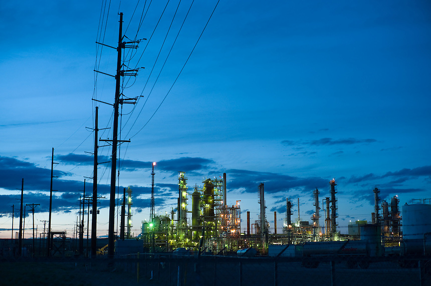 The lights of the Sinclair oil refinery glow near Casper, Wyo. Casper has a long history in the oil business (Photo/Kevin Moloney for the New York Times)