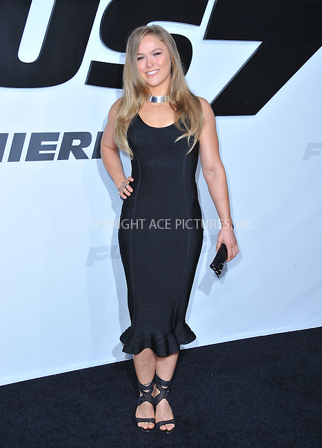 WWW.ACEPIXS.COM<br /> <br /> April 1 2015, LA<br /> <br /> Ronda Rousey arriving at Universal Pictures Premiere of 'Furious 7'' at the TLC Chinese Theatre, Hollywood, on April 1, 2015 in Los Angeles.CA <br /> <br /> By Line: Peter West/ACE Pictures<br /> <br /> <br /> ACE Pictures, Inc.<br /> tel: 646 769 0430<br /> Email: info@acepixs.com<br /> www.acepixs.com