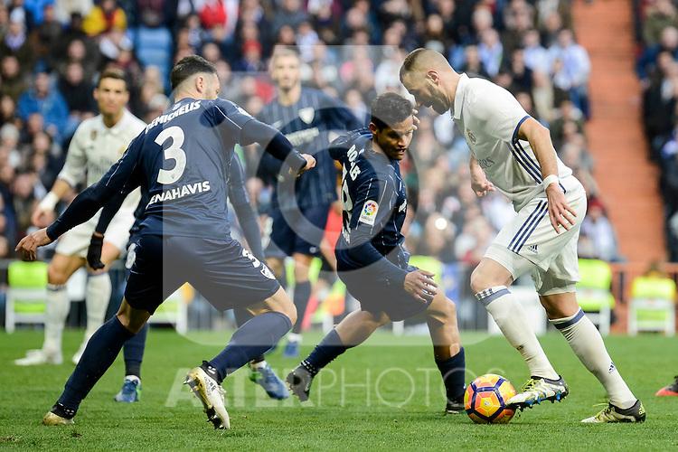 Real Madrid's Karim Benzema and Malaga CF's Weligton Robson during La Liga match between Real Madrid and Malaga CF at Santiago Bernabeu Stadium in Madrid, Spain. January 21, 2017. (ALTERPHOTOS/BorjaB.Hojas)