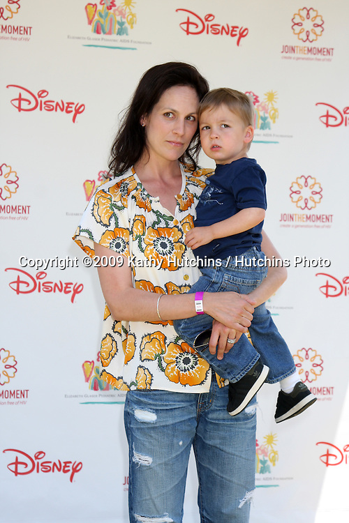 "Annabeth Gish & Son arriving at ""A Time For Heroes Celebrity Carnival"" benefiting the Elizabeth Glaser Pediatrics AIDS Foundation at the Wadsworth Theater Grounds in Westwood , CA on June 7, 2009 .©2009 Kathy Hutchins / Hutchins Photo.."
