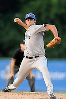 Starting pitcher Alex Balog (34) of the Asheville Tourists delivers a pitch in a game against the Greenville Drive on Tuesday, July 1, 2014, at Fluor Field at the West End in Greenville, South Carolina. Asheville won, 5-2. (Tom Priddy/Four Seam Images)