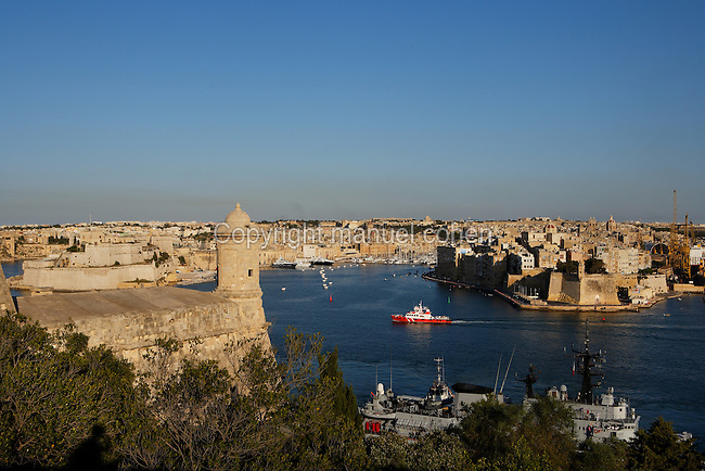 High angle view of the ramparts and the Three Cities, Valletta, Malta, pictured on June 6, 2008, in the afternoon. The Republic of Malta consists of seven islands in the Mediterranean Sea of which Malta, Gozo and Comino have been inhabited since c.5,200 BC. It has been ruled by Phoenicians (Malat is Punic for safe haven), Greeks, Romans, Fatimids, Sicilians, Knights of St John, French and the British, from whom it became independent in 1964. Nine of Malta's important historical monuments are UNESCO World Heritage Sites, including  the capital city, Valletta, also known as the Fortress City. Built in the late 16th century and mainly Baroque in style it is named after its founder Jean Parisot de Valette (c.1494-1568), Grand Master of the Order of St John.East of Valletta Harbour are the fortified towns known as the Three Cities. Picture by Manuel Cohen.