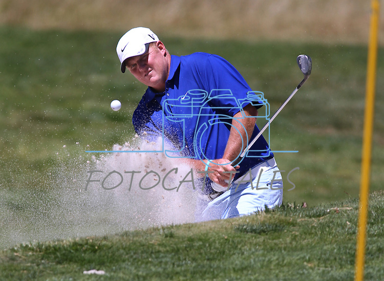 Billy Joe Tolliver hits out of the sand during a practice round at the 22nd American Century Celebrity Golf Championship at Edgewood Tahoe Golf Course in Stateline, Nev., on Wednesday, July 13, 2011. Tolliver is a three-time winner of the event. .Photo by Cathleen Allison