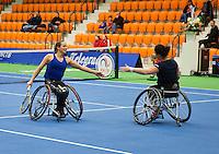 December 20, 2014, Rotterdam, Topsport Centrum, Lotto NK Tennis, Wheelchair doubles final Jiske Griffioen (L) and het partner Aniek van Koot<br /> Photo: Tennisimages/Henk Koster