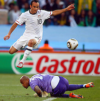 Landon Donovan (10) of USA skips over a challenge from Rais M'Bolhi goalkeeper of Algeria. USA defeated Algeria 1-0 in stoppage time in the 2010 FIFA World Cup at Loftus Versfeld Stadium in Pretoria, Sourth Africa, on June 23th, 2010.