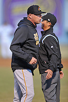 West Virginia Power pitching coach Jeff Johnson #23 is held back by umpire Derek Gonzalez after being ejected during a game against Asheville Tourists  at McCormick Field on April 9, 2014 in Asheville, North Carolina. The Tourists defeated the Power 5-3. (Tony Farlow/Four Seam Images)