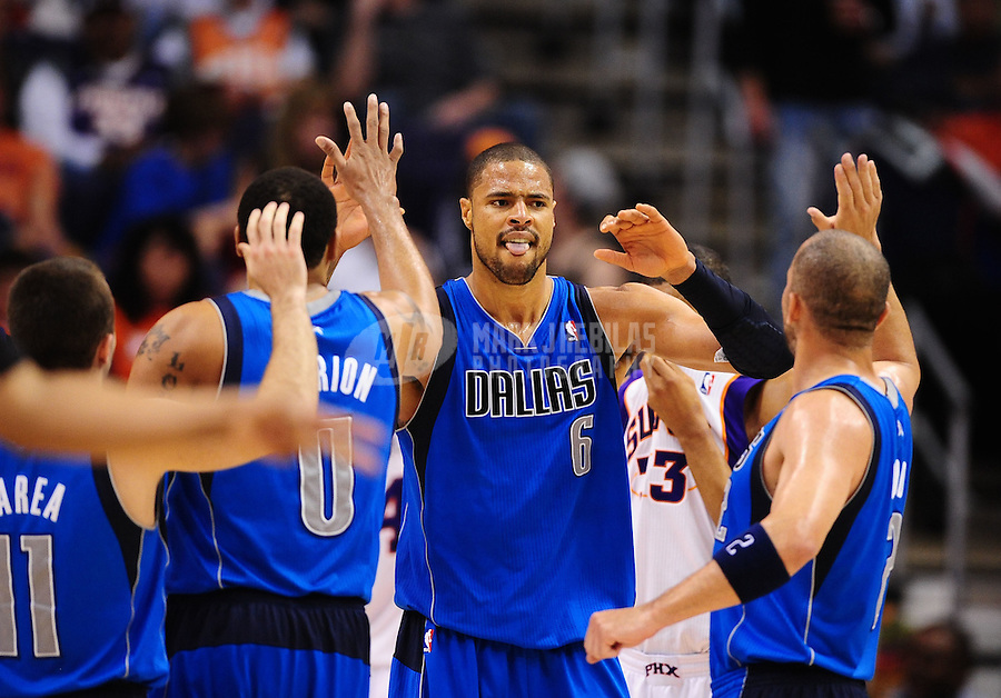 Mar. 27, 2011; Phoenix, AZ, USA; Dallas Mavericks center (6) Tyson Chandler celebrates with teammates in the second half against the Phoenix Suns at the US Airways Center. The Maverick defeated the Suns 91-83. Mandatory Credit: Mark J. Rebilas-
