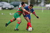 As he is tackled by S. Kata , R. Avei gets a grubber away. Counties Manukau Premier Club Rugby, Ardmore Marist vs Waiuku played at Bruce Pulman Park, Papakura on the 29th of April 2006. Ardmore Marist won 10 - 9.