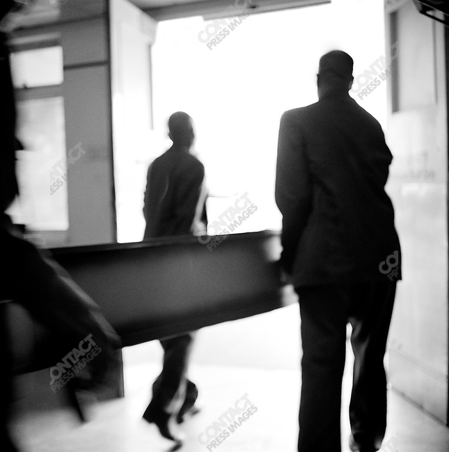 Family members carry the casket of an AIDS victim, Harare, Zimbabwe, January 2001
