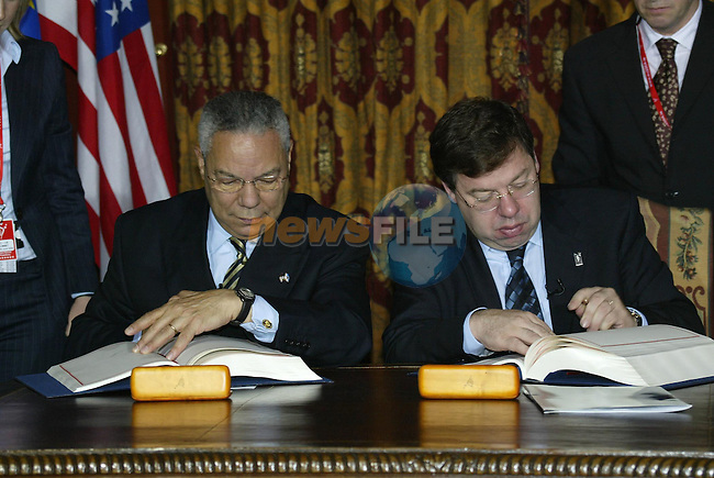 Newmarket-on-Fergus Ireland, US SECRETARY OF STATE COLIN POWELL WITH MINISTER FOR FOREIGN AFFAIRS BRIAN COWEN AT THE SIGNATURE OF AGREEMENT BETWEEN THE EU AND THE US ON THE GALILEO SATELLITE NAVIGATION SYSTEM DURING THE EU US SUMMIT 26/06/04.Photo AFP/NEWSFILE/MARK MAXWELL..(Photo credit should read MARK MAXWELL/NEWSFILE/AFP)...This Picture has been sent you under the condtions enclosed by:.Newsfile Ltd..the Studio,.Millmount Abbey,.Drogheda,.Co Meath..Ireland..Tel: +353(0)41-9871240.Fax: +353(0)41-9871260.GSM: +353(0)86-2500958.email: pictures@newsfile.ie.www.newsfile.ie.FTP: 193.120.102.198..This picture is from Fran Caffrey@newsfile.ie