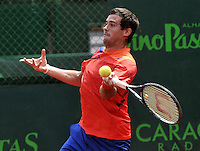 BOGOTA - COLOMBIA -07 -11-2013: Guido Pella, tenista de Argentina  devuelve la bola a Facundo Bagnis, tenista de Argentina, durante partido de la segunda ronda del Seguros Bolivar Open en el Club Campestre el Rancho de la ciudad de Bogota. / Guido Pella, Argentina tennis player returns the ball to Facundo Bagnis, Argentina tennis player during a match for the second round of the Seguros Bolivar Open in the Club Campestre El Rancho in Bogota city.Photo: VizzorImage  / Luis Ramirez / Staff.