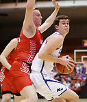 February 28, 2020; Yankton at St. Thomas More High School Basketball -- Ryder Kirsch #24 of St. Thomas More spins into Yankton defender Matthew Mors #32 during their game Friday evening at Barnett Arena in Rapid City, S.D.(Photo by Richard Carlson/Inertia)