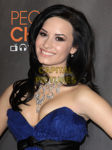 DEMI LOVATO.Arrivals at the 2010 People's Choice Awards held at the Nokia Theater L.A. Live in Los Angeles, California, USA. .January 6th, 2010 .headshot portrait silver necklace blue strapless cleavage .CAP/ADM/KB.©Kevan Brooks/AdMedia/Capital Pictures.