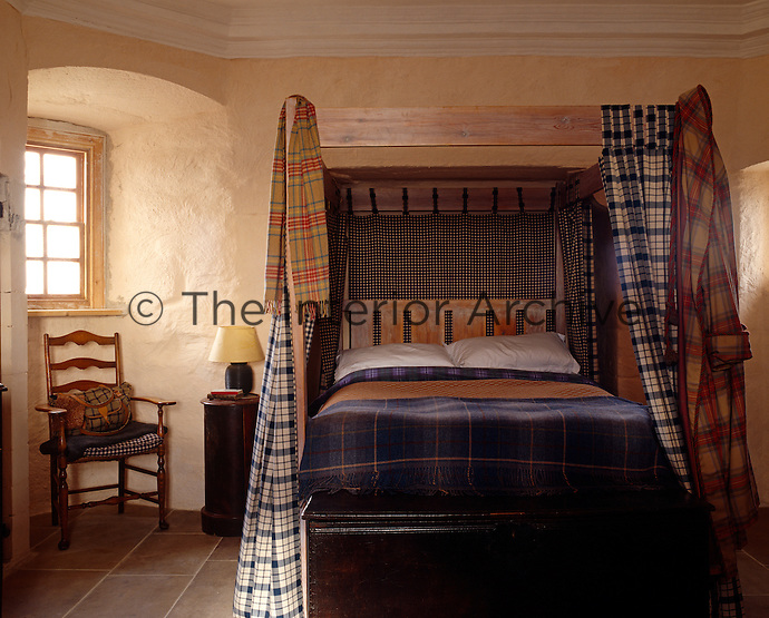 Checks and tartans give a touch of colour to this tower bedroom