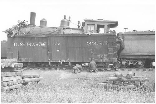 Engine #166 inside box car #3385.<br /> D&amp;RGW  Lumberton, NM  1923