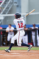 Isranel Wilson (12) of the Danville Braves follows through on his swing against the Princeton Rays at American Legion Post 325 Field on June 25, 2017 in Danville, Virginia.  The Braves walked-off the Rays 7-6 in 11 innings.  (Brian Westerholt/Four Seam Images)