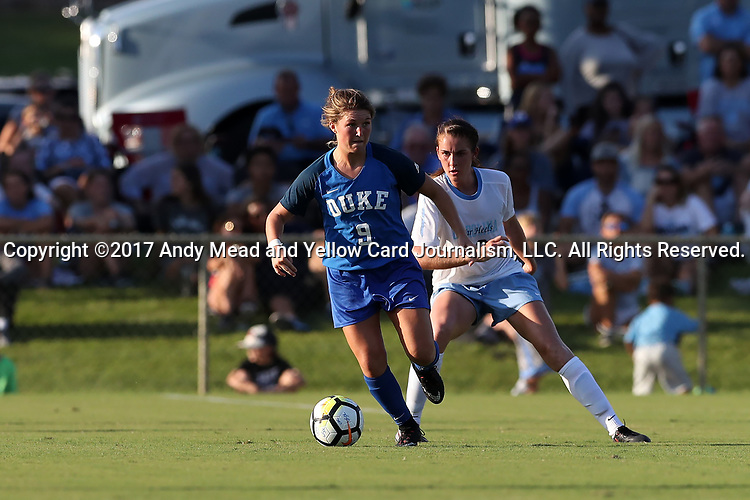CARY, NC - AUGUST 18: Duke's Kat McDonald (9) and North Carolina's Julia Ashley (16). The University of North Carolina Tar Heels hosted the Duke University Blue Devils on August 18, 2017, at Koka Booth Stadium in Cary, NC in a Division I college soccer game.