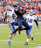 Virginia wide receiver Tim Smith (20) catches the ball in front of Duke cornerback Ross Cockrell (6) and Duke safety Jeremy Cash (16) during the game at Scott Stadium in Charlottesville, VA. Duke defeated Virginia 35-22. Photo/Andrew Shurtleff