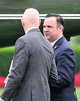 White House Director of Social Media Dan Scavino, right, chats with Director of Oval Office Operations Keith Schiller as they prepare to board Marine One to accompany United States President Donald J. Trump on his trip to Miami, Florida on Friday, June 16, 2017.  In Miami, the President will give remarks and participate in a signing on the United Statesí policy towards Cuba. Photo Credit: Ron Sachs/CNP/AdMedia