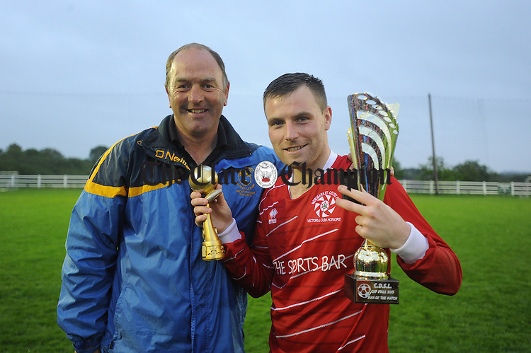 David Mc Carthy of Newmarket Celtic gets the man of the match and Top scorer award from Donie Garrihy following their Cup final win over Bridge United at Doora. Photograph by John Kelly.