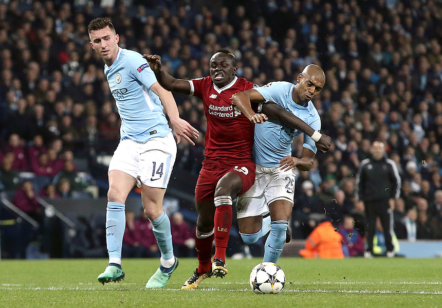 Liverpool's Sadio Mane battles with Manchester City's  Fernandinho<br /> <br /> Photographer Rich Linley/CameraSport<br /> <br /> UEFA Champions League Quarter-Final Second Leg - Manchester City v Liverpool - Tuesday 10th April 2018 - The Etihad - Manchester<br />  <br /> World Copyright &copy; 2017 CameraSport. All rights reserved. 43 Linden Ave. Countesthorpe. Leicester. England. LE8 5PG - Tel: +44 (0) 116 277 4147 - admin@camerasport.com - www.camerasport.com