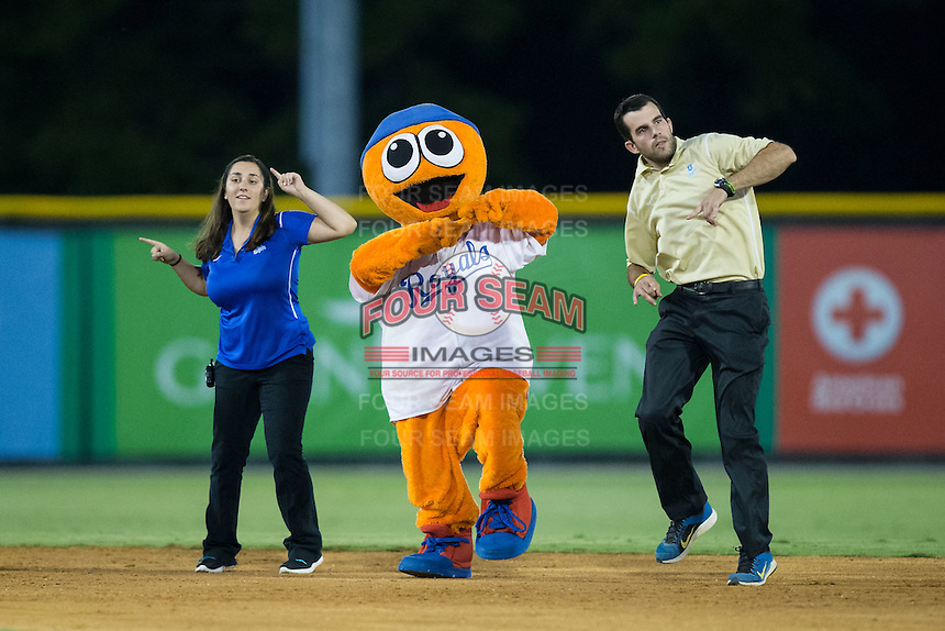 Nicole Miller (left) and Jared Orton (right) dance with the Burlington Royals mascot Bingo between innings of the Appalachian League game against the Johnson City Cardinals at Burlington Athletic Park on August 22, 2015 in Burlington, North Carolina.  The Cardinals defeated the Royals 9-3. (Brian Westerholt/Four Seam Images)