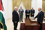 Mr. Mohamed Abdel Ghani Al-Aweiwi sworn in as a judge in the Constitutional Court in front of Palestinian President Mahmoud Abbas, in the West Bank city of Ramallah on June 13, 2019. Photo by Thaer Ganaim