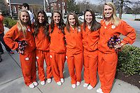 Clemson cheerleaders pose for photos during the Fan Fest before the Reedy River Rivalry game against the South Carolina Gamecocks on March 1, 2014, at Fluor Field at the West End in Greenville, South Carolina. South Carolina won, 10-2. (Tom Priddy/Four Seam Images)