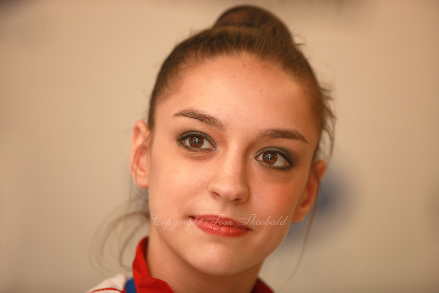 Evgenia Kanaeva of Russia smiles at press interview after winning All-Around gold at 2008 European Championships at Torino, Italy on June 6, 2008.  Photo by Tom Theobald.