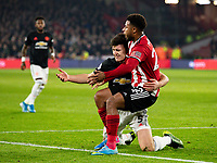 Manchester United's Harry Maguire grapples with Sheffield United's Lys Mousset <br /> <br /> Photographer Alex Dodd/CameraSport<br /> <br /> The Premier League - Sheffield United v Manchester United - Sunday 24th November 2019 - Bramall Lane - Sheffield<br /> <br /> World Copyright © 2019 CameraSport. All rights reserved. 43 Linden Ave. Countesthorpe. Leicester. England. LE8 5PG - Tel: +44 (0) 116 277 4147 - admin@camerasport.com - www.camerasport.com
