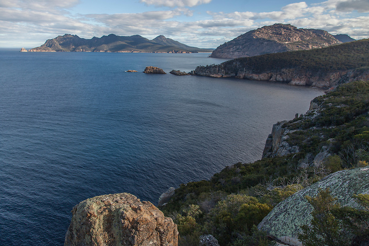 Freycinet NP boasts of sugar-white beaches, clear sapphire water, and the orange granite peaks of the Hazards.