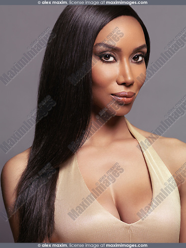 Beauty portrait of black african american woman with long straight hair isolated on gray background