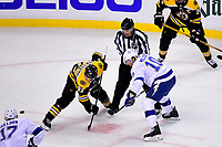 May 2, 2018: Boston Bruins center Patrice Bergeron (37) wins a face off against Tampa Bay Lightning center J.T. Miller (10)  during game three of the second round of the National Hockey League's Eastern Conference Stanley Cup playoffs between the Tampa Bay Lightning and the Boston Bruins held at TD Garden, in Boston, Mass. Tampa Bay defeats Boston 4-1. Eric Canha/CSM