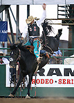 Isaac Diaz competes in the saddle bronc riding event at the Reno Rodeo in Reno, Nev., on Friday, June 20, 2014.<br />