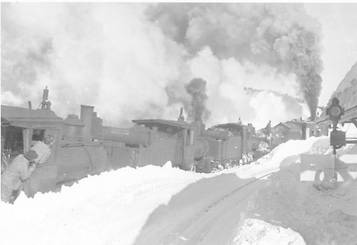 Rotary snowplow pushed by at least three engines clearing snow at Cumbres station.<br /> D&amp;RG  Cumbres, CO