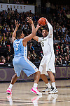 Devin Thomas (2) of the Wake Forest Demon Deacons is guarded by Kennedy Meeks (3) of the North Carolina Tar Heels during first half action at the LJVM Coliseum on January 21, 2015 in Winston-Salem, North Carolina.  The Tar Heels defeated the Demon Deacons 87-71.  (Brian Westerholt/Sports On Film)