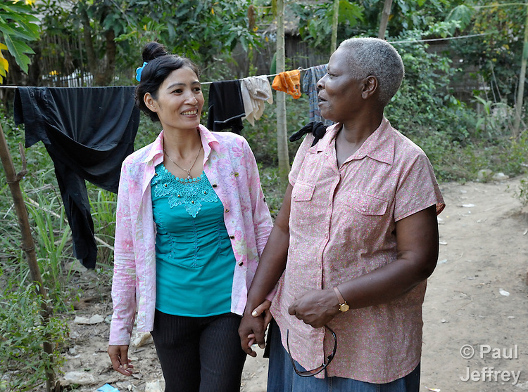 Irene Mparutsa, right, a United Methodist missionary, talks with a woman in the Cambodian village of Talom. Mparutsa works with the Community Health and Agricultural Development program of the Methodist Mission in Cambodia.