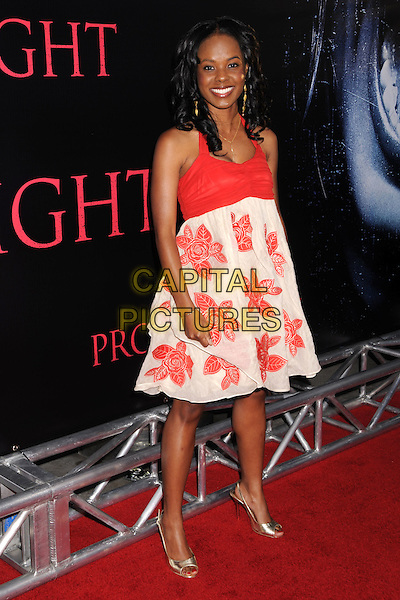 "DANA DAVIS.""Prom Night"" Los Angeles Premiere at the Cinerama Dome, Hollywood, California, USA..April 9th, 2008.full length white red pattern dress floral gold shoes .CAP/ADM/BP.©Byron Purvis/AdMedia/Capital Pictures."