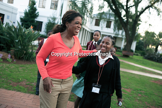 """JOHANNESBURG, SOUTH AFRICA AUGUST 10: Oprah talks to a group of girls after interviewing them for her school """"Oprah Winfrey Leadership Academy for Girls"""" located about 40 miles south of Johannesburg in Henley-on-Klip, Meyerton. Oprah visited South Africa to interview girls and to inspect the construction of the school. (Photo by Per-Anders Pettersson).."""