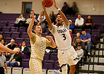 SIOUX FALLS, SD - NOVEMBER 25: Jerrod Walton #3 from the University of Sioux Falls takes the ball to the basket past Michael Lee #22 from Southwest Minnesota State University during their game Saturday night at the Stewart Center in Sioux Falls. (Photo by Dave Eggen/Inertia)