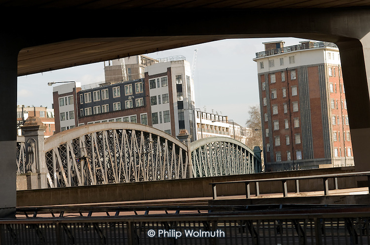 Westbourne Bridge over the railway line out of Paddington station, framed by the Westway flyover and the Harrow Road.