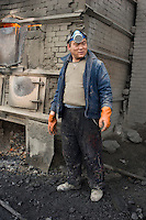 "A worker whose trousers have been shredded by acid at a private ""rare earth"" processing plant in Guyan County about 60 km from Bayan Obo, Inner Mongolia. China produces accounts for some 97% of rare earth consumed world-wide. The ""rare earth elements"" are a group of 17 elements that are essential in 25% of modern technology including cell phones, computer hard discs, and electric motors and inparticular green technology such as electric batteries and wind turbines. China yesterday, 23 September 2010, stopped trading rare earth with Japan, who rely on Chinese imports for its high tech industry,  over a territorial dispute. .."