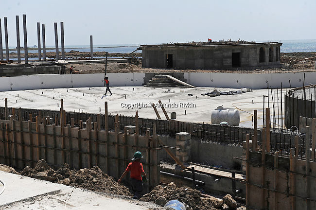 Construction workers are seen on site of the Khazar Islands project near Sahil, Azerbaijan on July 18, 2012.  The brainchild of Ibrahim Ibrahimov, an Azerbaijani oligarch and billionaire, the artificial Khazar Islands project just southwest of the Azerbaijani capital Baku is being built at a projected cost of $100 billion with an anticipated 800,000 housing units.