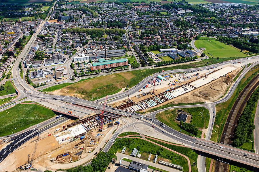 Nederland, Limburg, Maastricht, 27-05-2013; bouwwerkzaamheden voor de A2 traverse, De Groene Loper. <br /> <br /> De snelweg A2 gaat ondergronds, er wordt een gestapelde tunnel gebouwd (2 wegen boven elkaar). Het plan moet voor een betere bereikbaarheid en leefbaarheid van Maastricht zorgen en ook voor een betere doorstroming op de A2.<br /> Construction works for motorway A2 crossing Maastricht, the so-called Green Carpet.<br /> The A2 motorway goes underground, a stacked tunnel is  built with two roads above each other). The plan should provide better accessibility and traffic flow.<br /> luchtfoto (toeslag op standard tarieven);<br /> aerial photo (additional fee required);<br /> copyright foto/photo Siebe Swart.